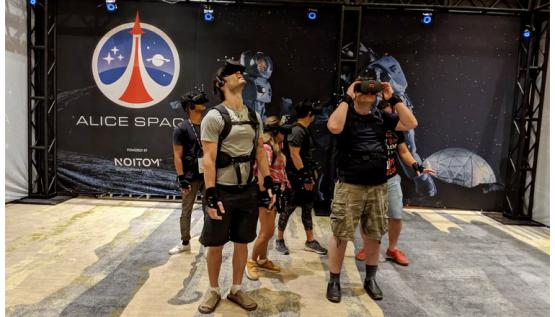 Visitors interact inside the Alice Space virtual reality experience by Noitom at SVVR 2017.