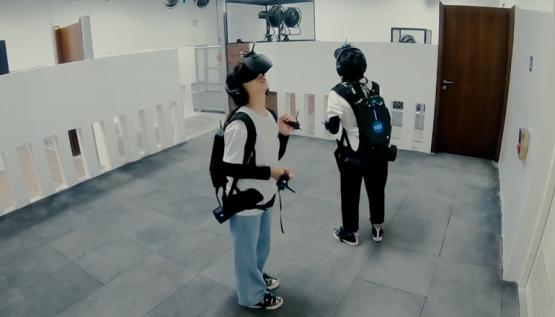 Players wear virtual reality goggles and Noitom motion capture sensors inside the Dauntless Fear Simulator at Lionsgate Entertainemnt World.